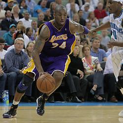 12 November 2008:  Los Angeles Lakers guard Kobe Bryant (24) drives past New Orleans Hornets forward James Posey (41) during a NBA regular season game between the Los Angeles Lakers and the New Orleans Hornets at at the New Orleans Arena in New Orleans, LA..