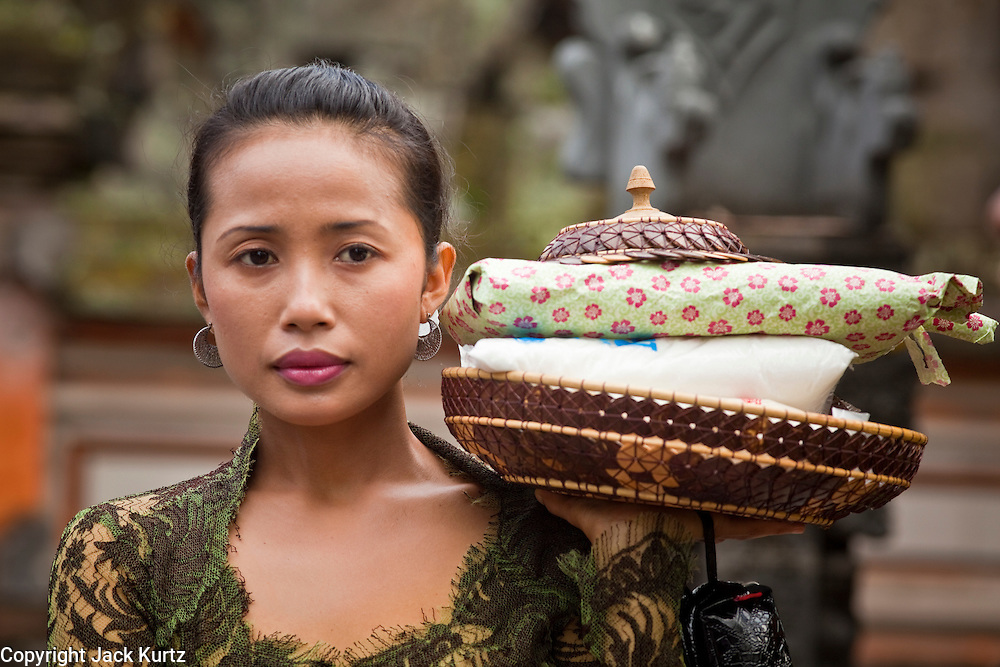Apr 24 - UBUD, BALI, INDONESIA: A woman brings gifts to a funeral for Bali's royal family in Ubud, Bali. Photo by Jack Kurtz/ZUMA Press