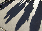 shadows of people standing