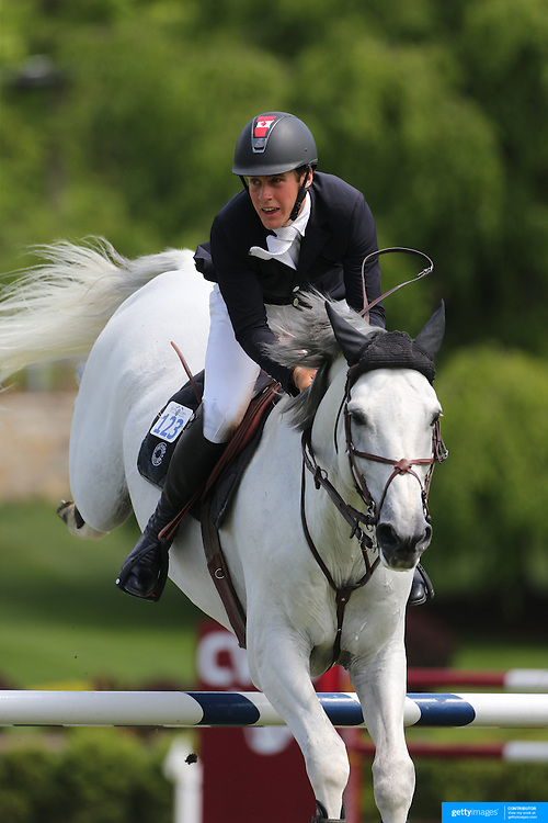 Ben Asselin riding Doremi in action during the $35,000 Grand Prix of North Salem presented by Karina Brez Jewelry during the Old Salem Farm Spring Horse Show, North Salem, New York, USA. 15th May 2015. Photo Tim Clayton