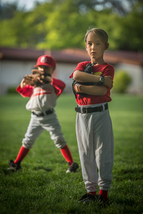 """Six year old Keaton Bramham (right) and J.P Birdwell (left) of the Saint Helena Volcanoes play the Calistoga Cheetahs at Calistoga Elementary School.  """"I had Keaton's baseball uniform in the washer and it was locked until the end of the cycle...we had to leave before it finished.  He's really upset that he's the only one without his jersey.""""   -Keaton's mother, Molly."""