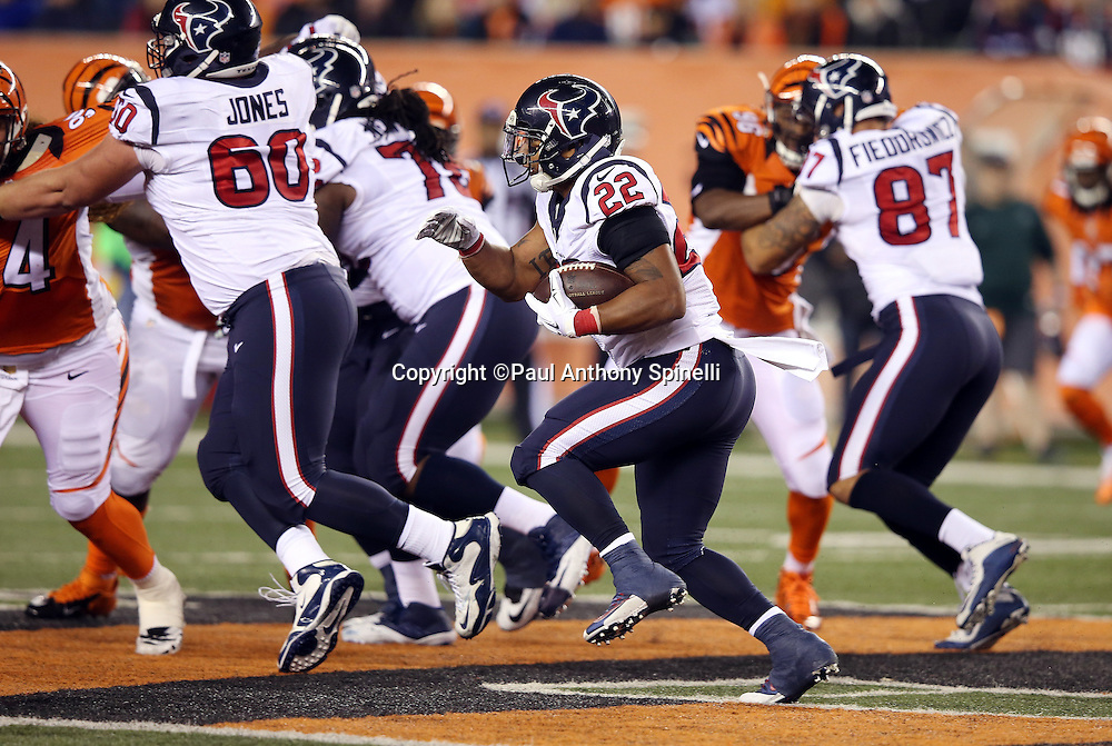 Houston Texans running back Chris Polk (22) runs the ball for a third quarter first down behind a block by Houston Texans center Ben Jones (60) during the 2015 week 10 regular season NFL football game against the Cincinnati Bengals on Monday, Nov. 16, 2015 in Cincinnati. The Texans won the game 10-6. (©Paul Anthony Spinelli)