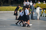 Japan, Hiroshima : HIROSHIMA, JAPAN - AUGUST 06: Kids of Hiroshima lays a wreath during the 70th anniversary ceremony of the atomic bombing of Hiroshima at the Hiroshima Peace Memorial Park on August 6, 2015 in Hiroshima, Japan. Japan marks the 70th anniversary of the first atomic bomb that was dropped by the United States on Hiroshima on August 6, 1945. The bomb instantly killed an estimated 70,000 people and thousands more in coming years from radiation effects. Three days later the United States dropped a second atomic bomb on Nagasaki which ended World War II.
