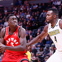 01 November 2017: Toronto Raptors forward Pascal Siakam (43) drives past Denver Nuggets forward Paul Millsap (4) during the Denver Nuggets 129-111 victory over the Toronto Raptors, at the Pepsi Center, Denver, Colorado, USA.