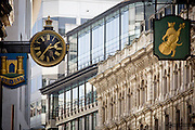 Banking institutions' street signs - incl TSB, left - on Lombard Street in the heart of the capital's financial district. A cat and fiddle with an ornate clock are with the background of more modern architecture. Such hanging signs were banned by Charles II, but replicas were erected for the coronation of Edward VII in 1902.