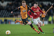 Sam Clucas (Hull City) and Oliver Burke (Nottingham Forest) during the Sky Bet Championship match between Hull City and Nottingham Forest at the KC Stadium, Kingston upon Hull, England on 15 March 2016. Photo by Mark P Doherty.
