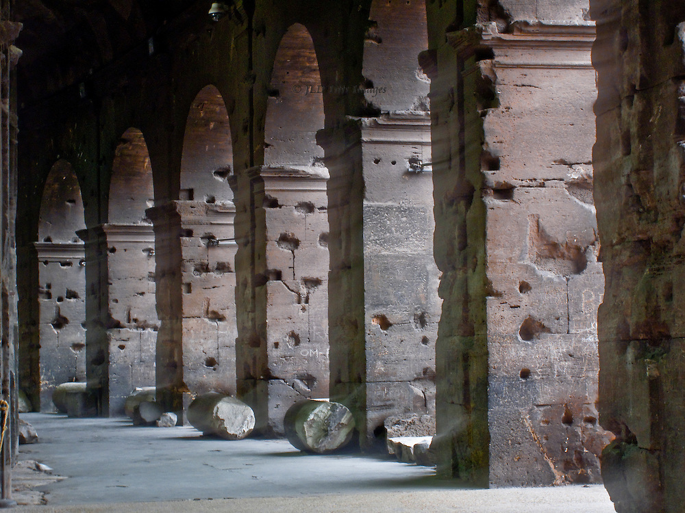Colosseum; outer corridor with external pillars, heavily pockmarked.