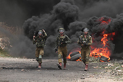 NABLUS, May 24, 2019, Nablus, West Bank, Occupied Territories:  Israeli soldiers hold their weapons during clashes with Palestinian protesters after a protest against the expanding of Jewish settlements in Kufr Qadoom village near the West Bank city of Nablus. (Credit Image: © Zhao Yue/Xinhua via ZUMA Wire)