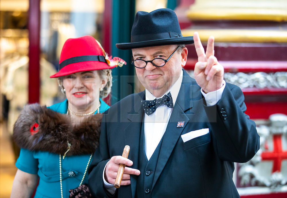 © Licensed to London News Pictures. 23/04/2018. London, UK. Winston and Clementine Churchill lookalikes join St George's Day celebrations in Leadenhall Market in London. Photo credit: Rob Pinney/LNP
