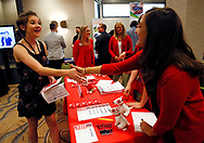 Job seeker Cailey Klinger (L) greets recruiters for Target at a job fair in Golden, Colorado June 7, 2017. REUTERS/Rick Wilking