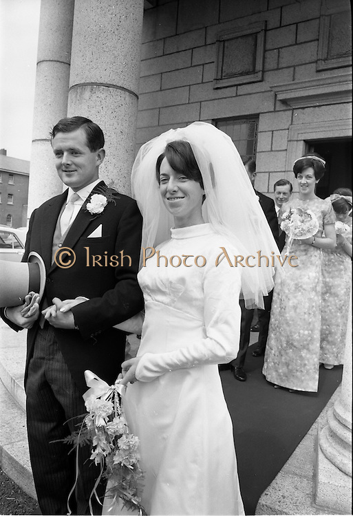 05/07/1967<br /> 07/05/1967<br /> 05 July 1967<br /> Wedding of George Walsh, eldest son of Mr and Ms Kevin G. Walsh, St. Rita's, Firhouse Road, Templeogue, Co. Dublin and Miss Arlene McMahon, elder daughter of Det. Chief Supt. Philip McMahon, Head of Special Branch, Dublin Castle and Mrs McMahon of Lisieux, Templeville Park, Templeogue, Co. Dublin who were married at the Carmelite Church, Terenure College, Dublin. An Taoiseach Mr Jack Lynch and Mrs Lynch; Mr Liam Cosgrave, leader Fine Gael and Mrs Cosgrave were among the 120 guests. Rev Fr H.E. Wright, O. Carm., Moate, officiated at the ceremony. The reception was held at Downshire Hotel, Blessington, Co. Wicklow. Picture shows the couple leaving the church after the ceremony.