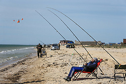 April 23, 2018 - Kyrylivka Urban-Type Settlement, Zaporizhzhia Region, Ukraine - An angler lounges in a folding chair by fishing rods set up on the shore of the Azov Sea near Kyrylivka urban-type settlement, Zaporizhzhia Region, southeastern Ukraine, April 23, 2018. Ukrinform. (Credit Image: © Dmytro Smolyenko/Ukrinform via ZUMA Wire)
