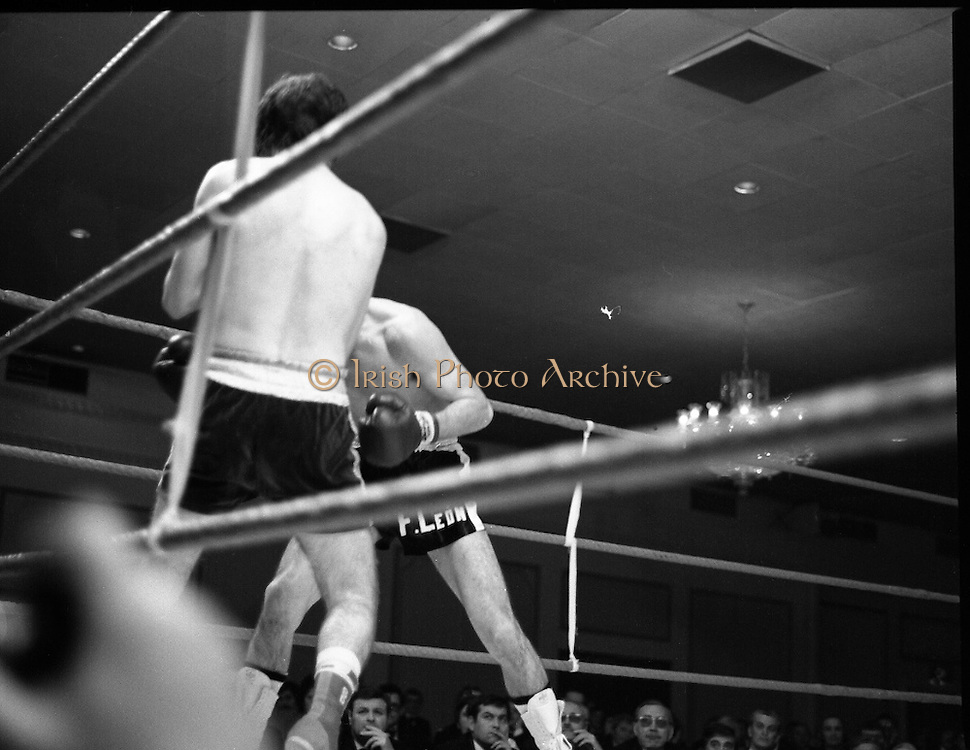 Nash vs Leon Championship Fight.    (N55)..1980..14.12.1980..12.14.1980..14th December 1980..At the Burlington Hotel, Dublin, Charlie Nash defended his European Lightweight Title when he took on Spain's Francesco Leon. .Image shows Leon throwing punches to the body of Nash.
