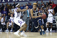 HIGH POINT, NC - JANUARY 06: Charleston Southern's Christian Keeling (11) and High Point's Austin White (left). The High Point University of Panthers hosted the Charleston Southern University Buccaneers on January 6, 2018 at Millis Athletic Convocation Center in High Point, NC in a Division I men's college basketball game. HPU won the game 80-59.