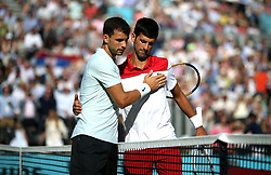 Serbia's Novak Djokovic (right) and Bulgaria's Grigor Dimitrov (left) after the match during day four of the Fever-Tree Championship at the Queen's Club, London. PRESS ASSOCIATION Photo. Picture date: Thursday June 21, 2018. See PA story TENNIS Queens. Photo credit should read: Steven Paston/PA Wire. RESTRICTIONS: Editorial use only, no commercial use without prior permission.