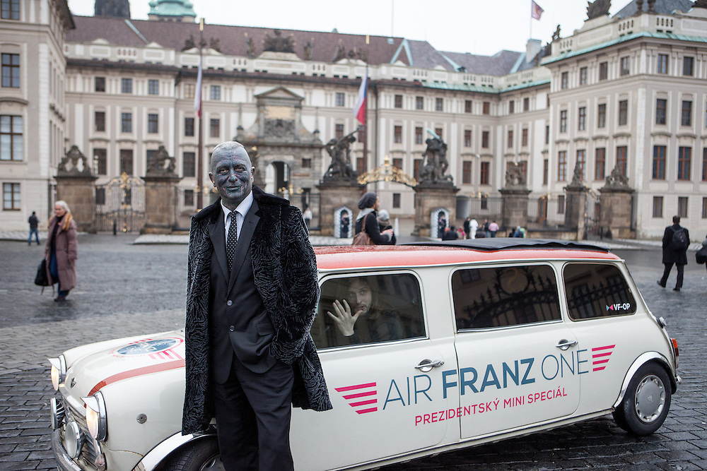 """Portrait of Prof. Vladimír Franz in front of Prague Castle and the """"Air Franz One"""" - his official campaign car - on his way from the Prague National Opera to a discussion with all Czech presidential candidates at the National Technical Library in Prague Dejvice. Franz is a prominent Czech composer and painter, stage music author and also a registered candidate in the 2013 Czech presidential election."""