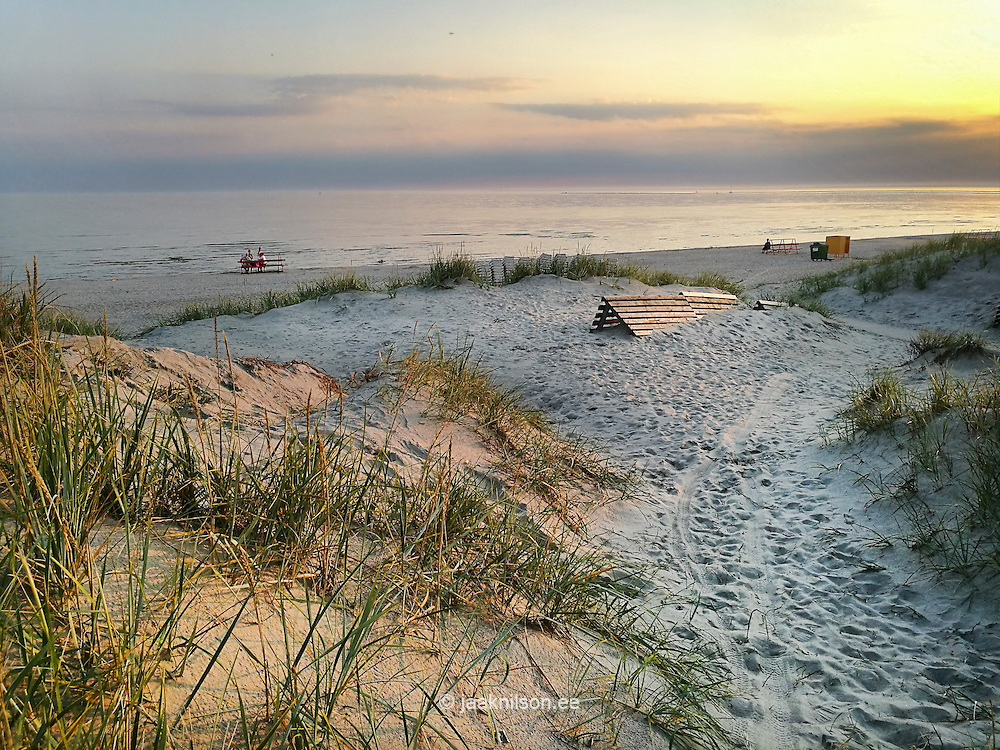 Sandy beach in Pärnu, Estonia. Seaside, evening, sunset. Sand dunes, sea, water.