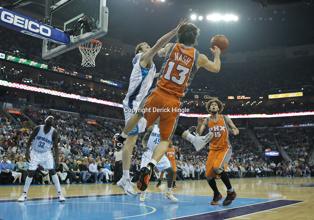 08 April 2009: New Orleans Hornets forward Sean Marks (4) defends as Phoenix Suns guard Steve Nash (13) passes to center Robin Lopez (15) during a NBA game between the New Orleans Hornets and the Phoenix Suns at the New Orleans Arena in New Orleans, Louisiana.