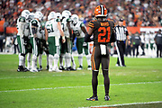 Cleveland Browns rookie cornerback Denzel Ward (21) looks on as the New York Jets offense huddles and calls a play during the 2018 NFL regular season week 3 football game against the New York Jets on Thursday, Sept. 20, 2018 in Cleveland. The Browns won the game 21-17. (©Paul Anthony Spinelli)