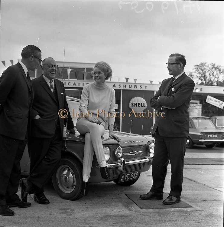 11/05/1965<br /> 05/11/1965<br /> 11 May 1965<br /> Rosemary Smith in Hillman Imp at end of the conclusion of a Round Ireland Endurance Run. Ms Smith on her car at the Ashurst Shell Service Station, Stillorgan Road, Dublin. With Edward Power, Managing Director, Dunlop Ltd.; Alec Buckley, Managing Director, Buckleys Motor Club,    and B.A. Nolan, Managing Director of Irish Shell.