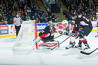 KELOWNA, CANADA - DECEMBER 30: Ty Edmonds #35 of Prince George Cougars defends the net against a shot from Gage Quinney #20 of Kelowna Rockets on December 30, 2014 at Prospera Place in Kelowna, British Columbia, Canada.  (Photo by Marissa Baecker/Shoot the Breeze)  *** Local Caption *** Ty Edmonds; Gage Quinney;