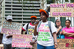 London, UK. 10 July, 2019. A Movement for Justice campaigner speaks at a protest outside the Home Office against the government department's decision to try to block the return to the UK of PN, a Ugandan lesbian removed from the UK using the now unlawful fast track procedure in 2013 but who the High Court ordered on 24th June must be returned to the UK by the Home Office after the handling of her case was ruled to be 'procedurally unfair'.