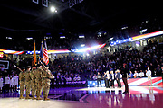 A color guard stands at attention during the National Anthem at the Cintas Center during an NCAA college basketball game between the Green Bay Phoenix and the Xavier Musketeers, Wednesday, Dec. 4, 2019, in Cincinnati. (Jason Whitman/Image of Sport)