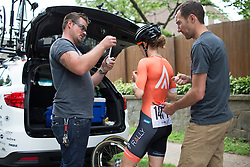 Heather Fischer (USA) of Rally Cycling Team checks her race radio for a last time before the Philadelphia International Cycling Classic, a 117.8 km road race in Philadelphia on June 5, 2016 in Philadelphia, PA.