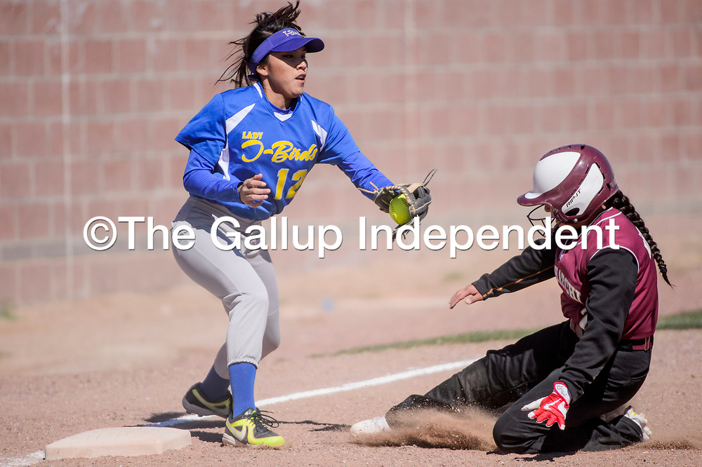 Tohatchi Cougar Shanika Becenti (7) slides into third base as Zuni Thunderbird Shicura Brown (12) reaches for the tag Friday at Tohatchi High School.
