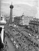 17/03/1955<br /> 03/17/1955<br /> 17 March 1955<br /> St. Patrick's Day Industrial parade in Dublin, run by the N.A.I.D.A.. The parade on O'Connell Street with a view of Nelson's Pillar.