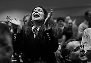 "Maha Elgibaly, of Fort Meyers, rejoices after she and 408 other immigrants are sworn in as American citizens at the second session of the Naturalization Oath Ceremony at the Tampa Convention Center in Tampa. Originally from Egypt, she has been living in the United States for 21 years. She said ""This is the best feeling I have ever had in my life.""  Individuals from 72 countries were represented at the afternoon ceremony."