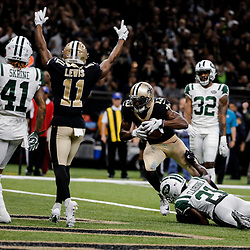 Dec 17, 2017; New Orleans, LA, USA; New Orleans Saints wide receiver Michael Thomas (13) scores past New York Jets cornerback Morris Claiborne (21) as wide receiver Tommylee Lewis (11) celebrates the score during the fourth quarter at the Mercedes-Benz Superdome. The Saints defeated the Jets 31-19. Mandatory Credit: Derick E. Hingle-USA TODAY Sports