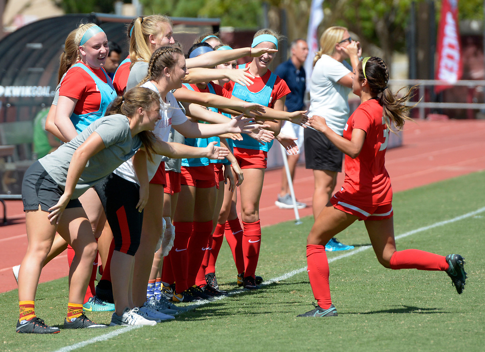 gbs091717k/SPORTS -- Jennifer Munoz, right, gets love from the bench after she scored the Lobos first point at the UNM Soccer Complex on Sunday, September 17, 2017. (Greg Sorber/Albuquerque Journal)