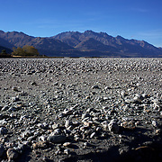 A dry bed on Dart River's braided river system in Mount Aspiring National Park. near Glenorchy..Glenorchy is a small settlement nestled in spectacular scenery at the northern end of Lake Wakatipu in New Zealand's south Island. It is approximately 45 kilometres by road or boat from Queenstown, the nearest large town..Glenorchy is a popular tourist spot, close to many tramping tracks. It lies near the borders of Mount Aspiring National Park and Fiordland National Park. The local scenery received worldwide attention when it was used as one of the settings in the first of Peter Jackson's Lord of the Rings films. Glenorchy is the home of  Dart River Jet Safaris. The  unique adventure combines exhilarating wilderness jet boating with unique Funyak inflatable canoes used to explore the magnificent World Heritage wilderness within Mt Aspiring National Park. Professional guides take participants through dramatic landscapes, paddling along channels of the glacier fed Dart River's braided river system as well as along hidden side streams, rock pools and dramatic chasms. Glenorchy, New Zealand. 13th April 2011. Photo Tim Clayton..