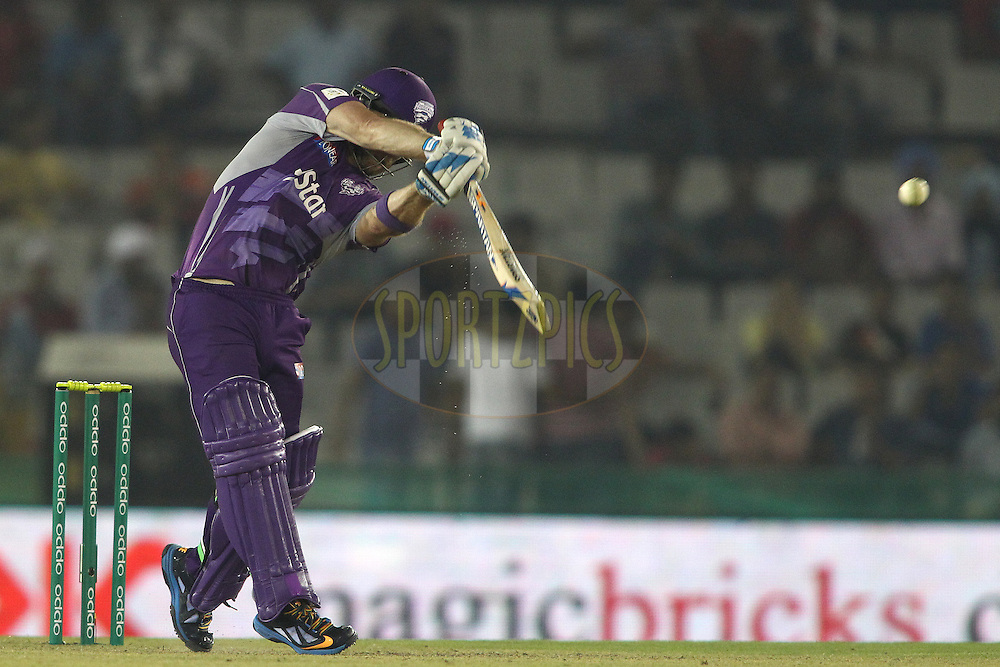 Aiden Blizzard of the Hobart Hurricanes hits a delivery on the up and is caught by Parvinder Awana of the Kings XI Punjab during match 2 of the Oppo Champions League Twenty20 between the Kings XI Punjab and the Hobart Hurricanes held at the Punjab Cricket Association Stadium, Mohali, India on the 18th September 2014<br /> <br /> Photo by:  Shaun Roy / Sportzpics/ CLT20<br /> <br /> <br /> Image use is subject to the terms and conditions as laid out by the BCCI/ CLT20.  The terms and conditions can be downloaded here:<br /> <br /> http://sportzpics.photoshelter.com/gallery/CLT20-Image-Terms-and-Conditions-2014/G0000IfNJn535VPU/C0000QhhKadWcjYs
