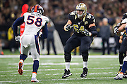 NEW ORLEANS, LA - NOVEMBER 13:  Zach Strief #64 of the New Orleans Saints drops back to block against Von Miller #58 of the Denver Broncos at Mercedes-Benz Superdome on November 13, 2016 in New Orleans, Louisiana.  The Broncos defeated the Saints 25-23.  (Photo by Wesley Hitt/Getty Images) *** Local Caption *** Zach Strief; Von Miller