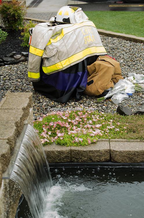 10Jun2013/Lanoka Harbor/NJ/USA/uniform sits outside of LHFD firehouse in memoriam