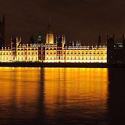 British Houses of Parliament at night with reflection on the River Thames taken from Queens Way. High resolution panorama.