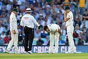 Mitchell Marsh of Australia feels the back of his leg as he pulls up with cramp on his bowling run up during the 5th International Test Match 2019 match between England and Australia at the Oval, London, United Kingdom on 12 September 2019.