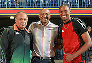 PRETORIA, SOUTH AFRICA, Friday 20 April 2012, Khosto Mokoena's coach, Hannes Coetzee, former sprint champion and IAAF member, Frank Fredericks and South African long jumper, Khotso Mokoena during the Yellow Pages Series 3 held at the Absa Tuks stadium..Photo by Roger Sedres/ImageSA/ASA