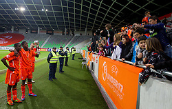 Players and fans of Netherlands celebrate with a trophy after winning the UEFA European Under-17 Championship Final match between Germany and Netherlands on May 16, 2012 in SRC Stozice, Ljubljana, Slovenia. Netherlands defeated Germany after penalty shots and became European Under-17 Champion 2012. (Photo by Vid Ponikvar / Sportida.com)