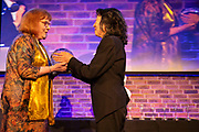 RPS Executive Director Rosemary Johnson, in her final awards, presented with a cut glass bowl by pianist and RPS Gold Medallist, Mitsuko Uchida and John Gilhooly, Chairman of the Royal Philharmonic Society<br /> Photographed at the RPS Music Awards, London, Wednesday 9 May<br /> Photo credit required:  Simon Jay Price<br /> www.rpsmusicawards.com  #RPSMusicAwards