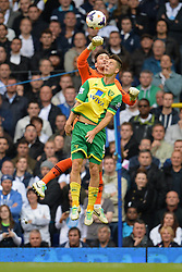 Tottenham's Heurelho Gomes punches the ball ahed of Norwich's Ricky van Wolfswinkel but was shown a yellow card as it was deemed out the area  - Photo mandatory by-line: Mitchell Gunn/JMP - Tel: Mobile: 07966 386802 14/09/2013 - SPORT - FOOTBALL -  White Hart Lane - London - Tottenham Hotspur v Norwich - Barclays Premier League