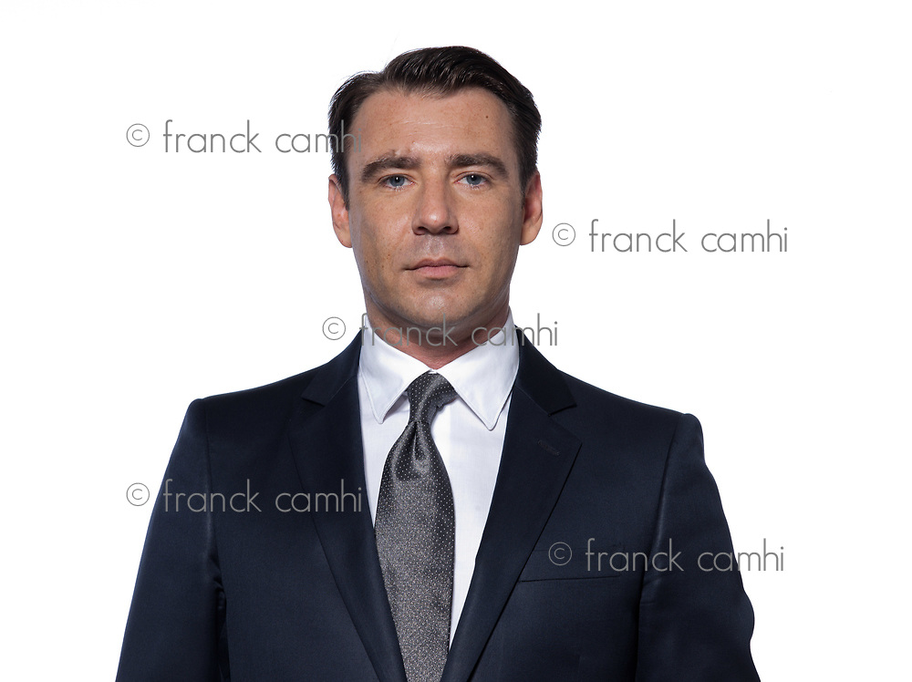 handsome caucasian man portrait isolated studio on white background with suit
