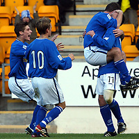 St Johnstone v St Mirren...25.10.03<br />John Robertson, Ross Forsyth and Simon Donnely mob Mark Robertson after he scored<br /><br />Picture by Graeme Hart<br />Perthshire Picture Agency<br />Tel: 01738 623350 / 07990 594431