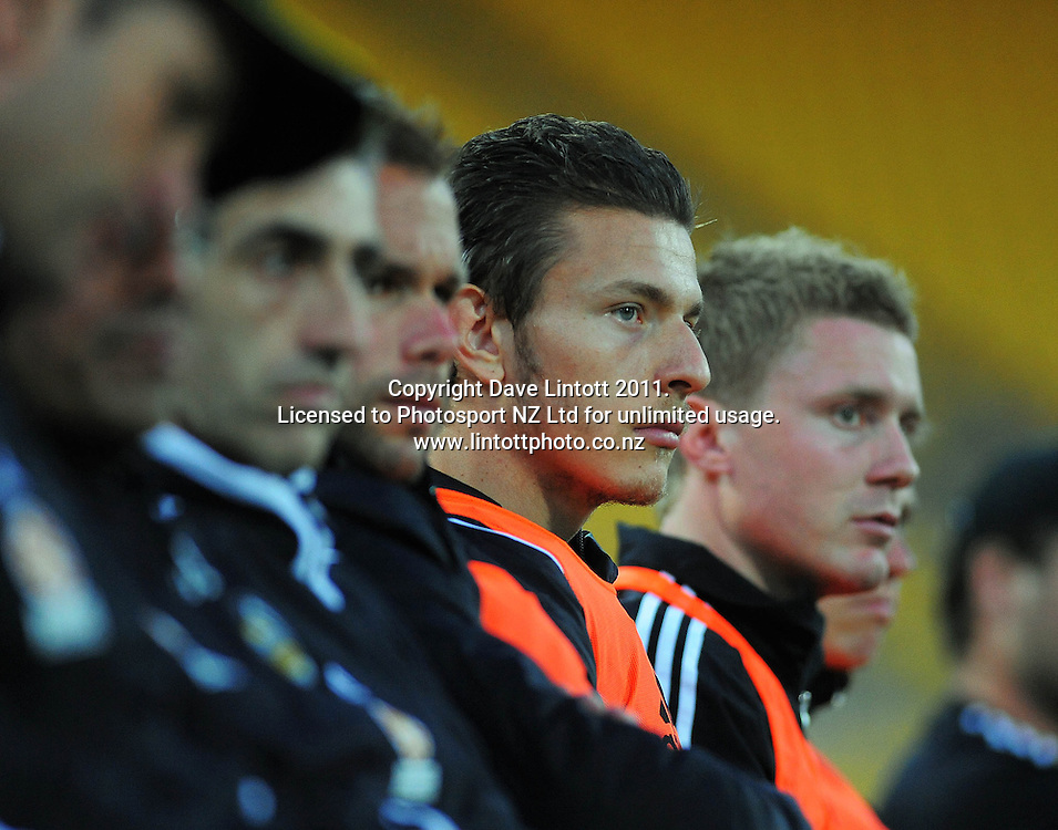 Mirjan Pavlovic watches from the Phoenix bench during the A-League football match between Wellington Phoenix v Newcastle Jets at Westpac Stadium, Wellington, New Zealand on Friday, 23 December 2011. Photo: Dave Lintott / lintottphoto.co.nz