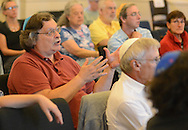 Carl Glassman (center) asks a question of Julie Seltzer, who was speaking about writing the Torah at Kehilat Hanahar Little Shul by the River Wednesday September 16, 2015 in New Hope, Pennsylvania.  (Photo by William Thomas Cain)