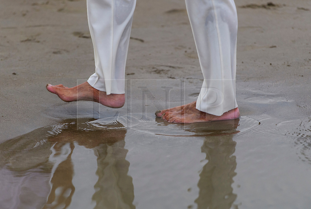 © Licensed to London News Pictures. 18/09/2016. Portsmouth, UK.  A bowlers barefoot in sea water. Teams take part in the  Bramble Bank Cricket Match in the middle of The Solent strait on September 18, 2016. The annual cricket match between the Royal Southern Yacht Club and The Island Sailing Club, takes place on a sandbank which appears for 30 minutes at lowest tide. The game lasts until the tide returns. Photo credit: Ben Cawthra/LNP
