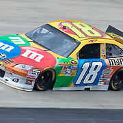 Kyle Busch #18 rounds turn three Friday May. 13, 2011 during NASCAR Sprint Cup Series practice race at Dover International Speedway in Dover Delaware....