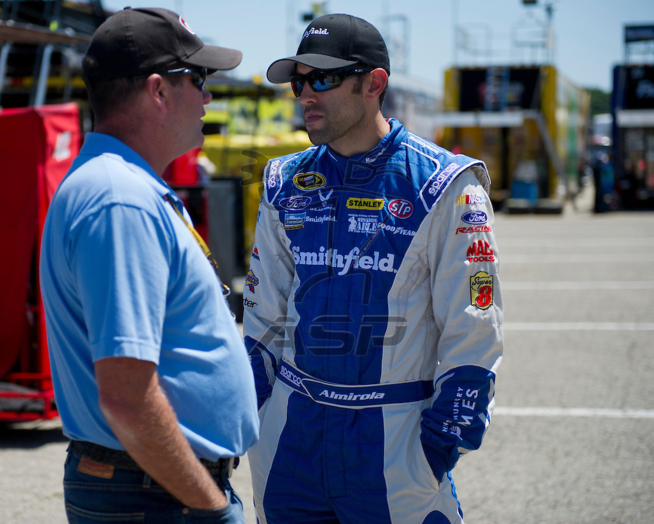 Brooklyn, MI - JUN 14, 2012:  Aric Almirola (43) prepares for the second test session for the Quicken Loans 400 race at the Michigan International Speedway in Brooklyn, MI.